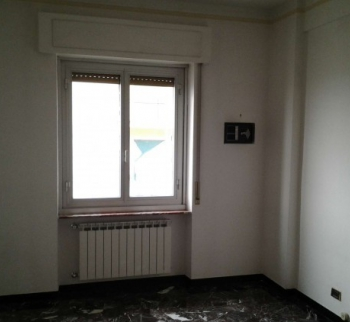 Three bedrooms in an apartment in Genoa